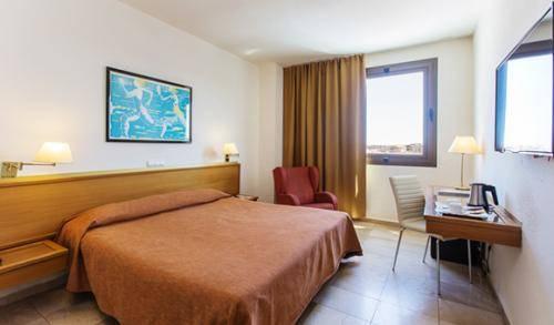 Habitaci n est ndar expo hotel valencia for Hotel habitacion familiar valencia